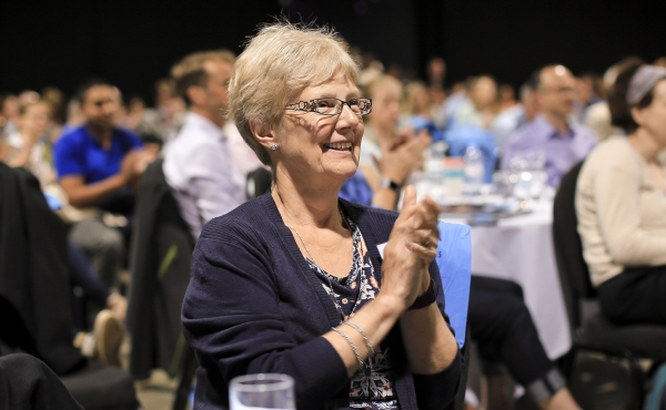 Delegate clapping at conference